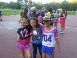 Campers enjoying the dance dressed as 'Athletes and Mathletes'